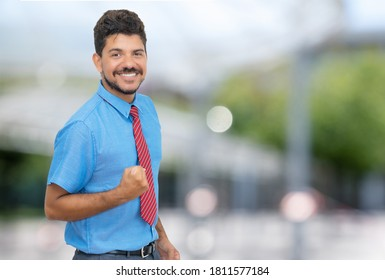 Successful hispanic businessmann with beard and tie outdoor in summer in city
