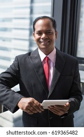 Successful Indian businessman with digital tablet