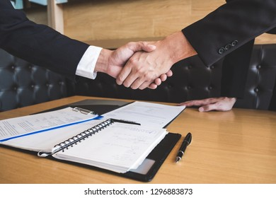 Successful job interview with boss and employee shaking hands after negotiation or interview, career and placement concept.