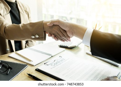Successful job interview with boss and employee handshaking after good deal, Congratulation, merger and acquisition partnership meeting concept.