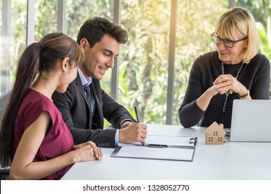Successful lawyer giving consultation to family couple agree to sign a contract  buying house