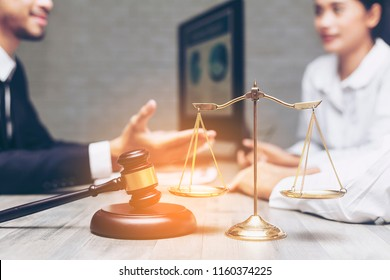 Successful lawyer giving consultation or real estate agent or financial advisor or Instructive meeting young Asian woman, insurance broker making purchase deal, investment or greeting at meeting