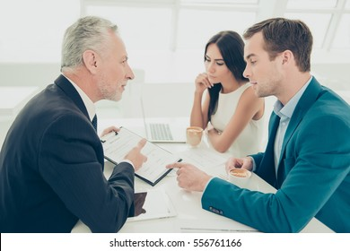 Successful lawyer showing new contract to his clients