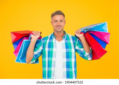 successful male shopping. handsome cheerful man with paperbags. purchase in paper bags. guy hold gift. holiday flash sale and special offer. cyber monday in shop. customer.