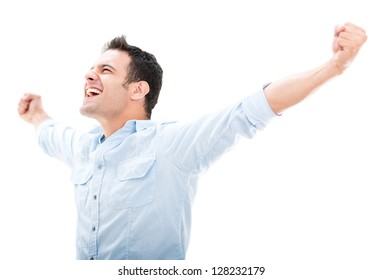 Successful man celebrating with arms up - isolated over white
