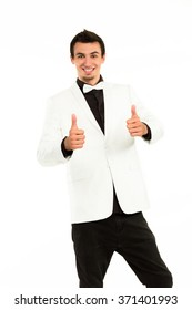 Successful man giving thumbs-up. Young smash manager showing thumbs-up. Nice man on white background.