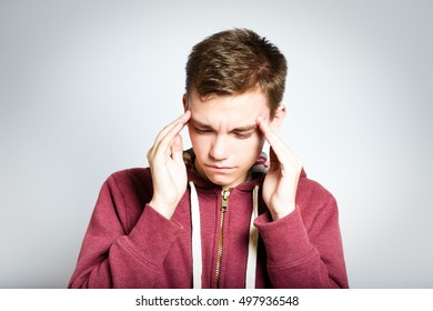successful man has a headache, isolated on a gray background