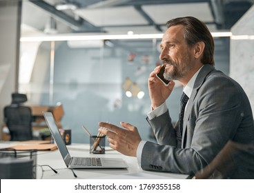 Successful man having discussion and deciding on matter in modern bright office