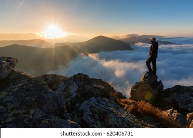 Successful man hiker on top of mountain