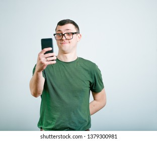 successful man making photo by phone, studio photo over background