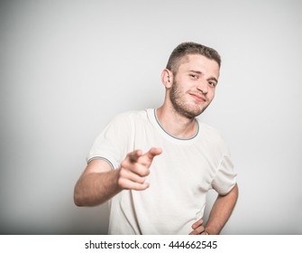 successful man points a finger at you, isolated on a gray background