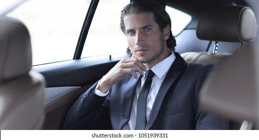 successful man sitting in the car