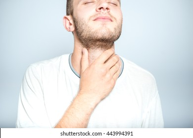 successful man with strep throat, isolated on a gray background