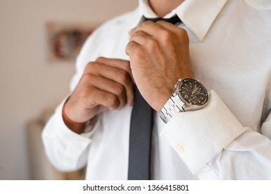 Successful man with white shirt ties necktie