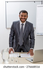 Successful manager in his office. Business coach in the workplace.