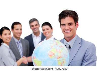 Successful manager and his team holding a terrestrial globe against a white background