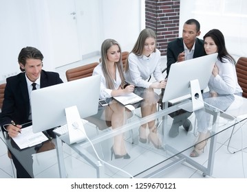 successful managers discussing new business project in modern office