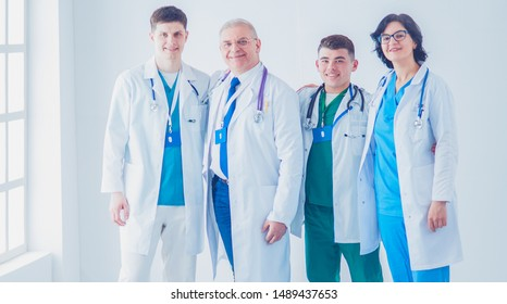 Successful medical team. Confident doctors team standing together and smiling