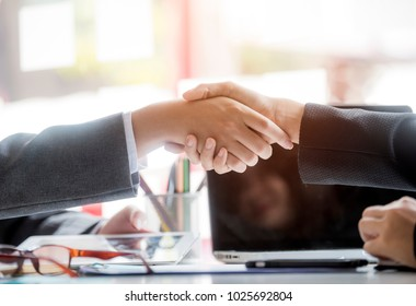 Successful meeting,two confident businessman shake hands with each other at modern office
