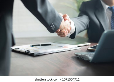 Successful negotiating business concept, Businessmen shaking hands after finishing meeting or setting  goals and planning way to success in front of building