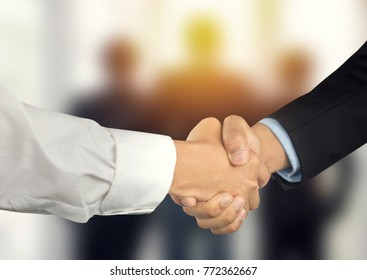 Successful negotiating business concept, Businessmen shaking hands after finishing meeting or setting  goals and planning way to success
