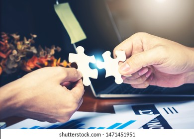 Successful negotiation join partnership with puzzle jigsaw hands Teamwork support build dream team cooperation meeting. Connect communication solve problem together in social network digital business
