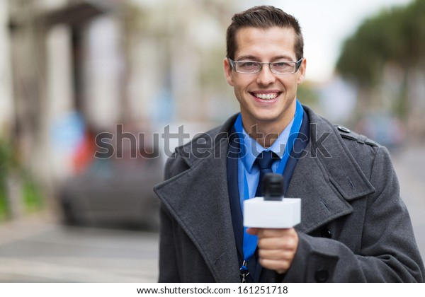 successful news reporter working in a cold weather outdoors