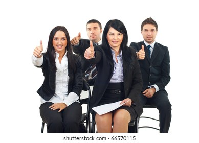 Successful people at the conference sitting on chairs and giving thumbs up isolated on white background