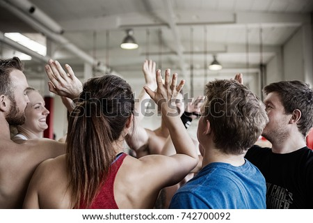 Successful People Giving High Five To Each Other In Gymnasium
