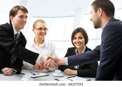 Successful people shaking hands making a necessary agreement