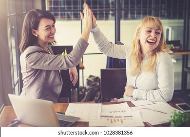 Successful professional and beautiful  business women, Partner Shakehand to celebrate  project agreement in the meeting. Happy conversation between businesswomen friendship, partn and teamwork concept