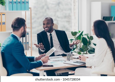 Successful, professional, stylish, attractive, elegant managers having business conversation, sitting in work place, wearing classic suits, trying to find a solution, solve problems, expressing ideas