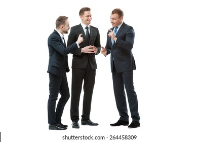 Successful project. Full length of three cheerful business people in formalwear discussing something and gesturing. Isolated on white.