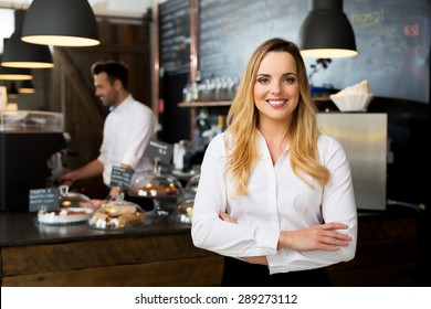 Successful restaurant manager, small business owner at work
