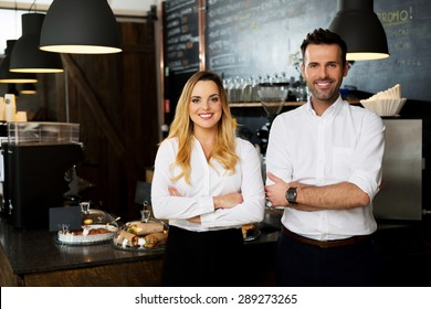Successful restaurant managers standing together