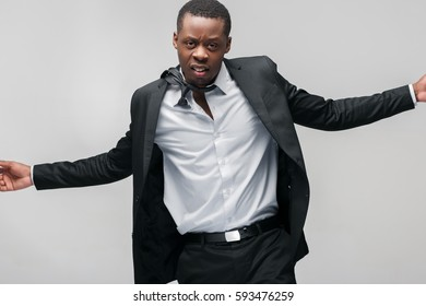 Successful rich businessman. Wealth, power, authority, prestige, win, success. Afroamerican guy on grey background with copy space