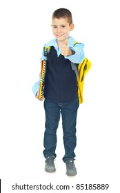Successful schoolboy in first day of school giving thumb up isolated on white background