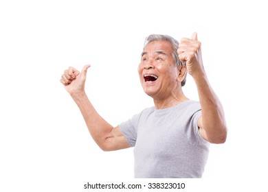 successful senior man looking up with thumb up gesture