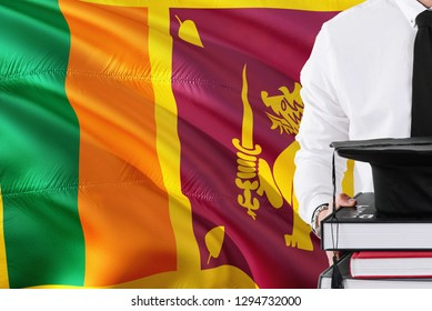 Successful Sri Lankan student education concept. Holding books and graduation cap over Sri Lanka flag background.