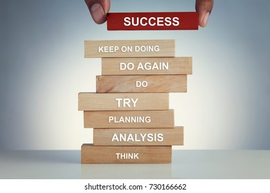 Successful steps on wooden block