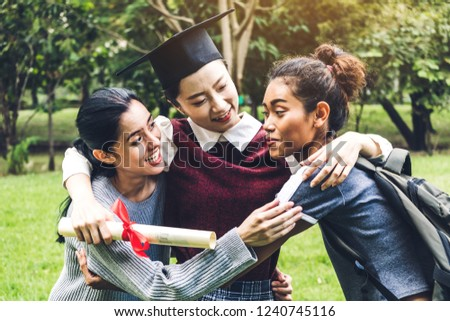 2f8341a7aa2 Successful of student young woman and bachelor gowns with diplomas graduate  hugging her friend at university