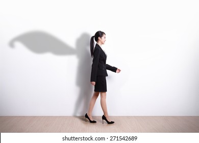 Successful Superhero business woman walking with white wall background, asian
