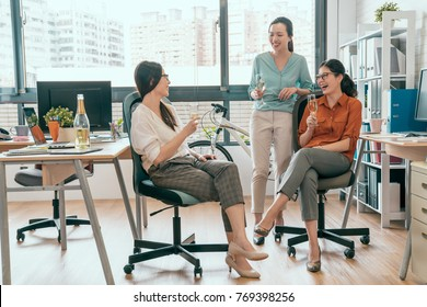 Successful team celebrates concept. Group of cheerful young people discussing something with smile while sitting or standing in office