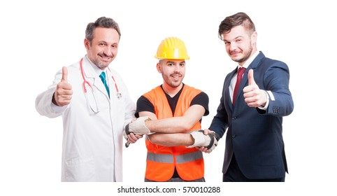 Successful team with doctor, builder and lawyer shaking hands and doing like sign as cooperation concept on white background