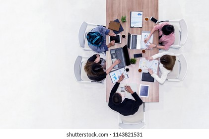 Successful team leader and business owner leading informa or Cheerful Business People Analyzing Statistics Financial in a meeting at modern office. Asian Teamwork Meeting Corporate Concept