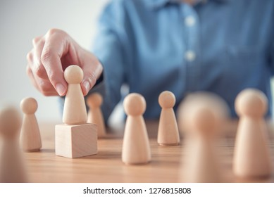 Successful team leader, Businessman hand choose people standing out from the crowd.