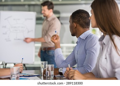 Successful team leader with his team at meeting room.