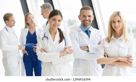 Successful team of medical doctors are looking at camera