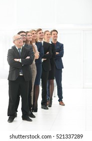 Successful team of staff standing in a row
