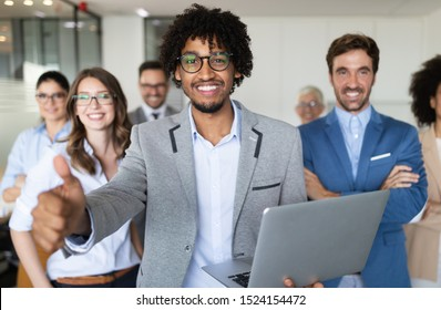 Successful team of young perspective businesspeople in office - Shutterstock ID 1524154472